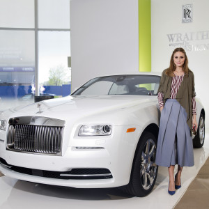 """NEW YORK, NY - MAY 08:  Fashion Icon Olivia Palermo receives a first look at Rolls-Royce Motor Cars' latest design creation, Wraith """"Inspired by Fashion"""" during the global debut of the stunning bew motor car at an exclusive event in the heart of New York City at IAC Building on May 8, 2015 in New York City.  (Photo by Brian Ach/Getty Images for Rolls-Royce)"""